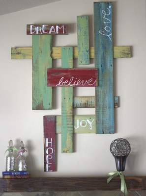 With a little paint and imagination, wood from pallets can be repurposed as word art.