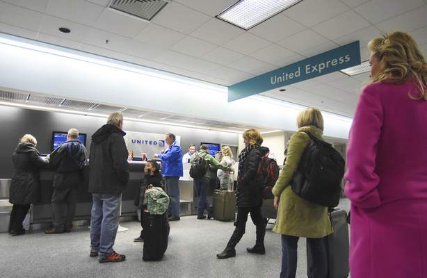 Rachel Von | The Journal Gazette Passengers check in Monday at the United Express counter at Fort Wayne International Airport. Passenger traffic increased 11 percent in 2015.