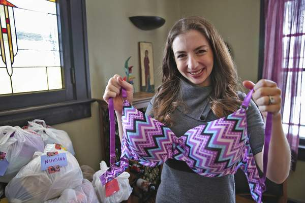 The Indianapolis Star Rachael Heger shows some of the bras she has gathered through donations at her Indianapolis home. Inspired by a similar campaign in Washington, D.C., Heger plans to donate the bras to homeless women in Indianapolis.
