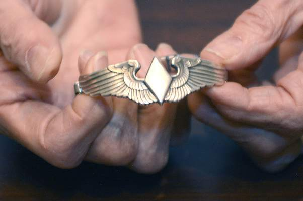 Samuel Hoffman | The Journal Gazette Marty Wyall holds the wings she received upon completing training for Women Airforce Service Pilots in 1944.