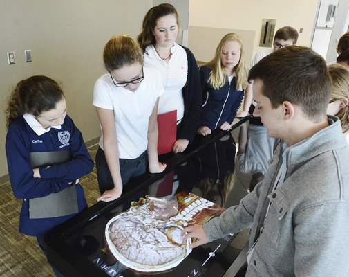 Cathie Rowand | The Journal Gazette Canterbury seventh-graders tour Parkview's medical simulation lab after attending the Rare Disease Day conference on Monday.