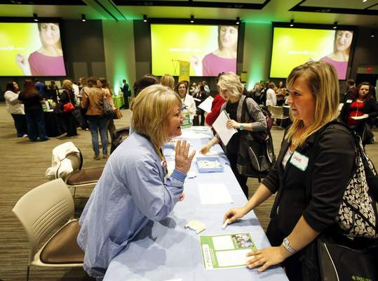 Photos by Chad Ryan | The Journal Gazette Brenda Wobler, left, perioperative manager at Parkview Randallia, talks with recent IUPUI graduate Cassie Vodde about nursing opportunities in her division during a Parkview Health hiring expo on Thursday at the Mirro Center for Research and Innovation. More than 300 people signed up to attend the event for registered nurses.
