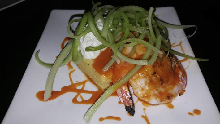 The Buffalo Shrimp with polenta cake and bleu cheese foam at Old Crown Coffee Roasters on Anthony Boulevard.