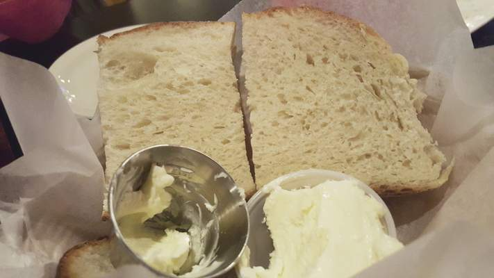 Chef Jeremy Selvio makes the house bread from scratch at Old Crown Coffee Roasters on Anthony Boulevard.
