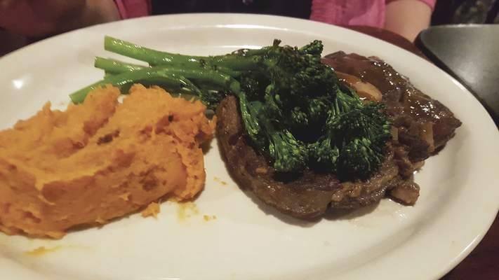 THe Beef Osso Bucco with bacon-sweet potato mash and sauteed broccolini at Old Crown Coffee Roasters on Anthony Boulevard.
