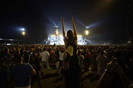 People dance at the Rolling Stones concert in Havana, Cuba, Friday March 25, 2016. The Stones performed in a free concert in Havana, becoming the most famous act to play Cuba since its 1959 revolution. (AP Photo/Ramon Espinosa)