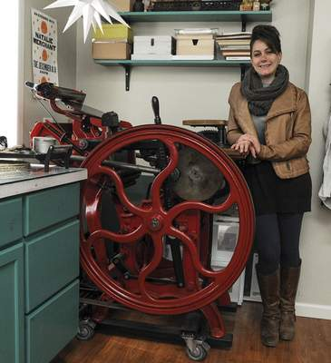 Michelle Davies   The Journal Gazette Julie Wall, owner of Hedgehog Press, stands with a letterpress machine from 1897 that she named Ginger. Wall will move her printing business to a historic building on Broadway that was the site of the former Canton Laundry.
