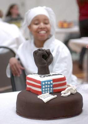 Ariell Morrison, an Ivy Tech senior studying baking and pastry, shows off her dark chocolate and white cake that was inspired by the Emancipation Proclamation. The festival featured 20 culinary students and a few outside bakeries competing in a bake-off in which the cakes and sweets were based on famous literature or document.