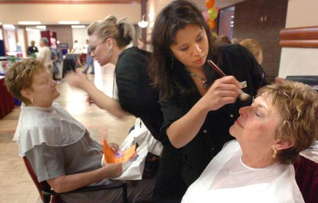 File: Masters of Cosmetology students working with patrons.
