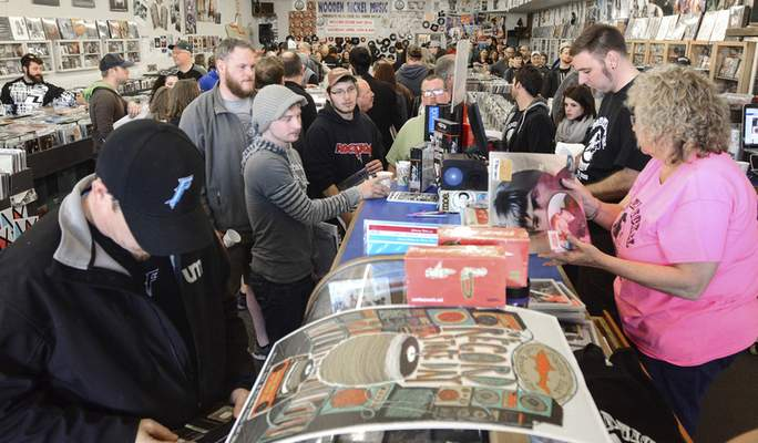 Photos by Michelle Davies   The Journal Gazette Customers at Wooden Nickel Records waited in line around 45 minutes to buy vinyl during Saturday's Record Store Day 2016. Fort Wayne had five stores take part in the annual event.