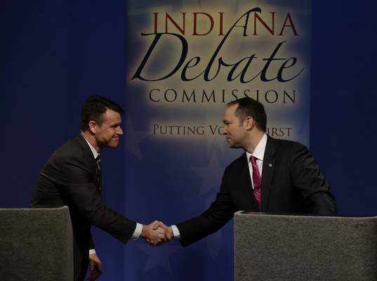 Indiana Republican candidates for U.S. Senate Marlin Stutzman, right, shakes hands with opponent Todd Young following their debate in Indianapolis, Monday, April 18, 2016. (AP Photo/Michael Conroy)