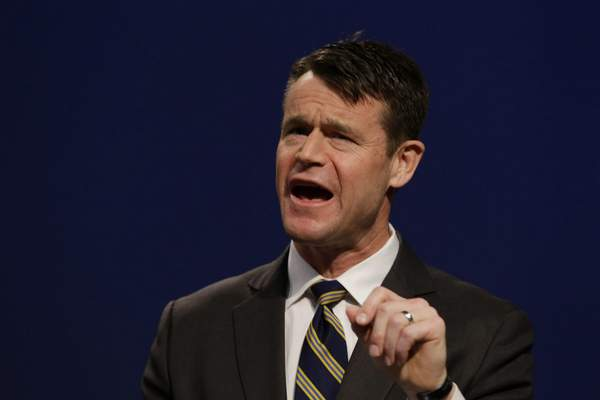 Indiana Republican candidate for U.S. Senate Todd Young speaks during a debate with opponent Marlin Stutzman watches as in Indianapolis, Monday, April 18, 2016. (AP Photo/Michael Conroy)