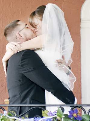 Rachel Von | The Journal Gazette Brandon Krontz, left, kisses his bride Samantha Hicks during their wedding at Shepherd's House, 519 Tennessee Ave, Fort Wayne, IN on Sunday. Brandon is a graduate of Shepherd's House and is doing very well in his recovery.