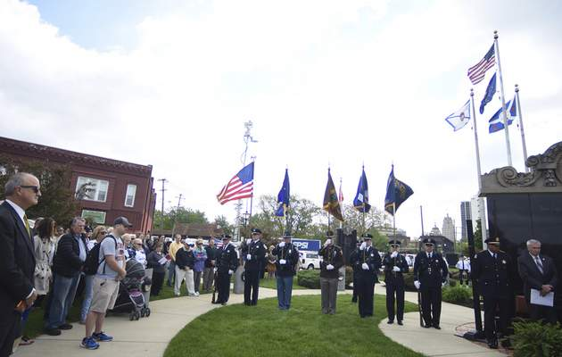 Rachel Von | The Journal Gazette Guests listen and the Fort Wayne Police Department Honor Guard holds flags during the 14th annual Police Officer Memorial Ceremony held at The Law Enforcement/Fire Fighter Memorial, 1001 North Wells Street in Fort Wayne, IN on Friday. GALLERY