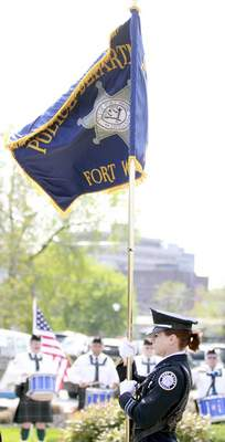 Rachel Von | The Journal Gazette Detective Shannon Hughes of the Fort Wayne Police Department Honor Guard carries a flag during the 14th annual Police Officer Memorial Ceremony held at The Law Enforcement/Fire Fighter Memorial, 1001 North Wells Street in Fort Wayne, IN on Friday. GALLERY