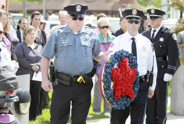 Rachel Von | The Journal Gazette Officer Jon Bonar, left, and Lt. Matt Enyeart carry the wreath during the wreath presenation at the 14th annual Police Officer Memorial Ceremony held at The Law Enforcement/Fire Fighter Memorial, 1001 North Wells Street in Fort Wayne, IN on Friday. GALLERY