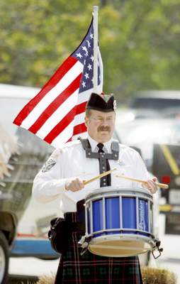 Rachel Von | The Journal Gazette Fort Wayne Police Department Pipe and Drum Brigade's Bill Michales plays the snare drum during the 14th annual Police Officer Memorial Ceremony held at The Law Enforcement/Fire Fighter Memorial, 1001 North Wells Street in Fort Wayne, IN on Friday. GALLERY