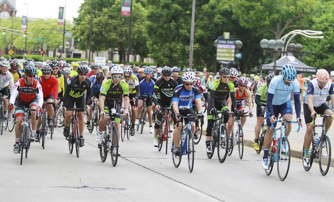 Photos by Rachel Von | The Journal Gazette Cyclists ride through the starting point of the Fort4Fitness Spring Cycle's new 100-kilometer ride Saturday morning on Main Street in downtown Fort Wayne. Other distances cyclists could take part in were 10, 16, 34 and 44 miles.