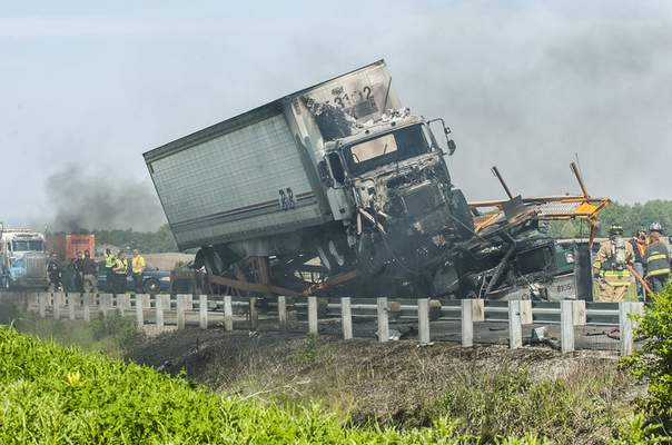 Cathie Rowand | The Journal Gazette One semi sits on top of another on U.S. 30 in Columbia City on Tuesday after the driver of one of the semis fell asleep and rammed the other.