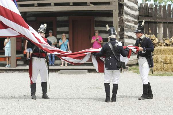 Michelle Davies   The Journal Gazette Visitors to the Old Fort watch as soldiers take down the flag during Sunday's celebration of Indiana's bicentennial. With Video