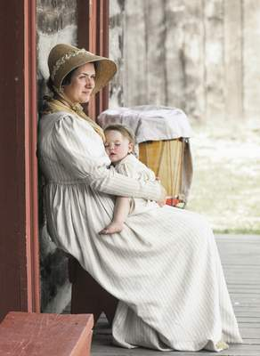 Michelle Davies   The Journal Gazette Miriam Homkes, 1, enjoys a nap in the arms of her aunt, Ruth Swearingen, during Sunday's celebration of Indiana's bicentennial at the Old Fort. With Video