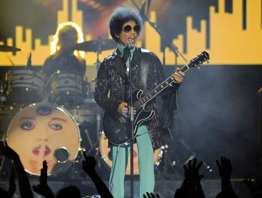 FILE - In this May 19, 2013, file photo, Prince performs at the Billboard Music Awards at the MGM Grand Garden Arena in Las Vegas. (Photo by Chris Pizzello/Invision/AP, File)