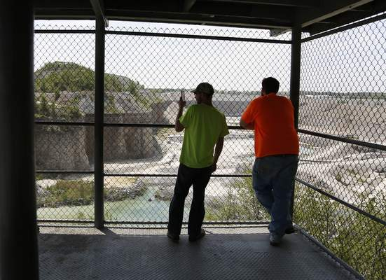 Chad Ryan | The Journal Gazette A couple of first-time visitors to the Hanson Aggregates observation deck off Ardmore Road look at the operation of the rock quarry from 150 feet above the quarry floor.