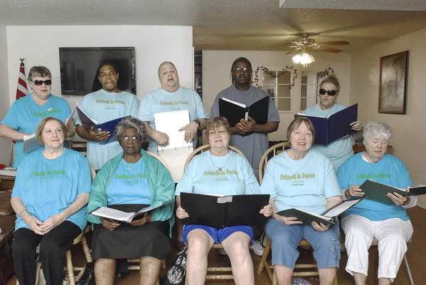 Michelle Davies | The Journal Gazette Friends in Focus, an a capella chorus composed of blind and visually impaired singers, will perform the national anthem for the TinCaps game at Parkview Field on Saturday, then sing at Make Music Day on Tuesday at Freimann Square.