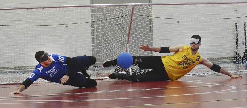 Californians Grej Pesjaka, left, and Abel Del Torro block the ball during goalball practice at Turnstone.