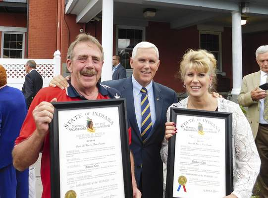 Jamie Duffy   The Journal Gazette Indiana Gov. Mike Pence presented Shepherd's House founders Lonnie and Barb Cox with Sagamore of the Wabash awards on Wednesday for their dedication to helping veterans.