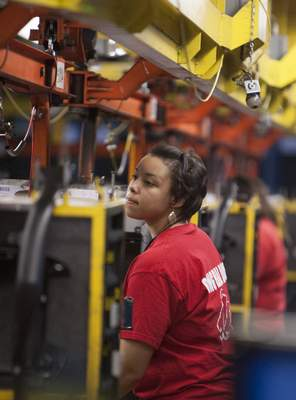 File: An employee works in the instrument panel assembly area at the Fort Wayne GM Truck Assembly Plant.