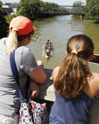 Spectators watch the dragon boat races from the Harrison Street Bridge during the second annual Riverpalooza event.