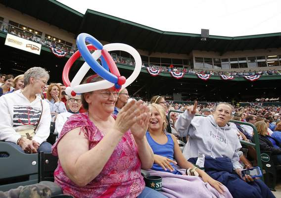 Tina Thompson claps along as Heaven Marcum, 9, laughs with her at Sunday's Patriotic Pops concert.