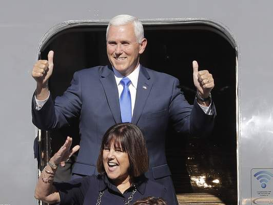 Associated Press Gov. Mike Pence reacts with his wife, Karen, as they arrive in Zionsville on Saturday for a welcome-home rally after Pence's appearance in New York with Donald Trump.