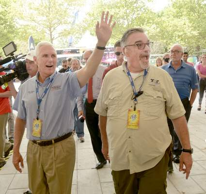 Samuel Hoffman | The Journal Gazette Indiana Governor Mike Pence, left, and Three Rivers Festival director Jack Hammer tour Headwaters Park, Wednesday, July 12, 2016.