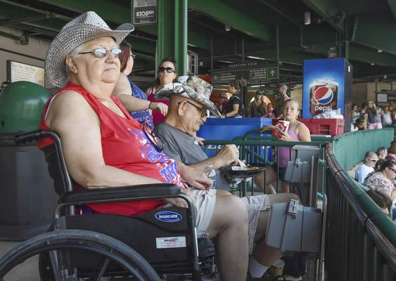Carol and Ken Henry, of Fort Wayne, try to beat the heat as they attend their second CountryFest at Parkview Field.
