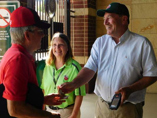 Brian Francisco | The Journal Gazette U.S. Sen. Joe Donnelly and Parkview Field employee Pat Evans scan a fan's ticket to Tuesday's TinCaps game.