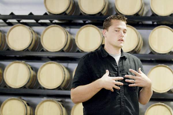 Rachel Von   The Journal Gazette CEO Stephen Blevins talks about the business while standing in front of bourbon and spiced rum that are aging in previously unused 5-gallon barrels during a tour of Three Rivers Distilling Co., 224 E. Wallace St.