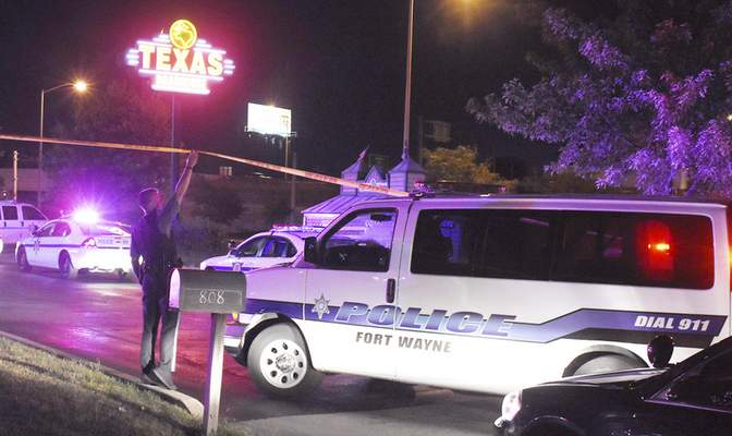 Rachel Von | The Journal Gazette A police van enters the police tape at the site of a shooting at Texas Roadhouse, 710 W Washington Center Rd, Fort Wayne, IN on Sunday night.