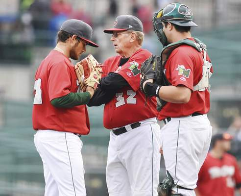 Rachel Von | The Journal Gazette TinCaps' pitching coach Burt Hooton talks with pitcher Thomas Dorminy and catcher Austin Allen after several walks during a game against Bowling Green at Parkview Field.