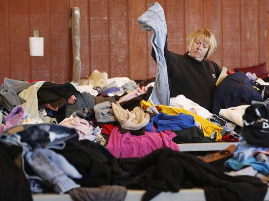 File: A consumer looks at a pair of blue jeans while shopping at the St. Louis Besancon Parish rummage sale. Census data shows Indiana as one of only eight states that saw income inequality increase from 2014 to 2015.