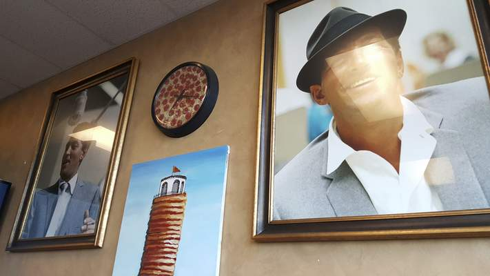 Dean Martin posters adorn the walls of Amore's Pizza on Dupont Road.