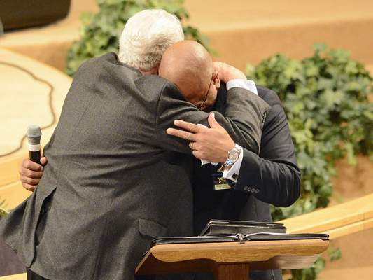 Chad Ryan | The Journal Gazette Jerry Vandeveer, left, hugs Fort Wayne Fraternal Order of Police President Mitchell McKinney during an emotional moment as McKinney delivers his comments about his friend Linda Vandeveer during her funeral services on Monday at First Assembly of God church on Washington Center Road. Numerous family members, friends, police officers, firefighters and local officials said their goodbyes to the community activist after she lost her battle with cancer on September 29. Vandeveer and her husband Jerry worked with local law enforcement clean up their neighborhood of crime and drug houses and helped build the Law Enforcement/Firefighters Memorial on Wells Street.