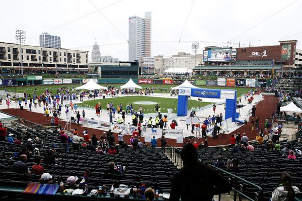 Chad Ryan   The Journal Gazette The Fort4Fitness Fall Festival finish line and medal presentations take up the infield at ParkviewField on Saturday. (with video)