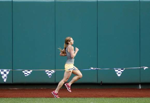 Chad Ryan   The Journal Gazette Kasi Maple runs along the warning track at Parkview Field as she heads toward teh finish of the half marathon during the Fort4Fitness Fall Festival on Saturday. (with video)