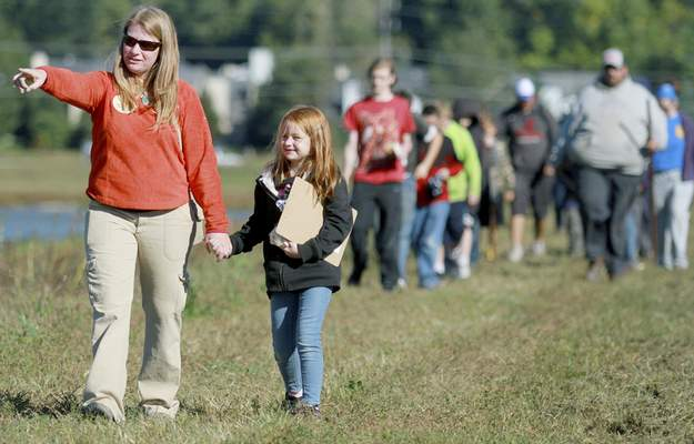 Photos by Rachel Von   The Journal Gazette Betsy Yankowiak, director of preserves and programs, walks with daughter Zoey, 6, as she leads the inaugural hike of the new 3.1-mile Continental Divide Trail at the Little River Wetlands Project's Eagle Marsh Preserve on Saturday.