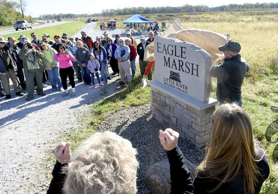 A new sign at the entrance to Eagle Marsh along Engle Road is unveiled before the start of the inaugural hike of the Continental Divide Trail on Saturday.