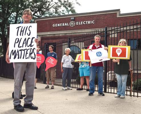FILE People gather at the General Electric campus to voice concern over the future of the site.