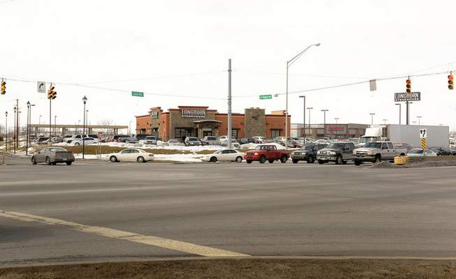 File The development at Interstate 69 and Lima Road, featuring a Longhorn Steakhouse, Costco and Kelley Chevrolet, representsa successful TIF district.