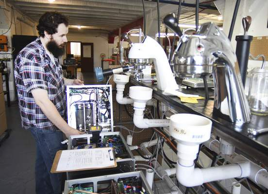 Nick Stolle tests espresso modules for water leaks at the manufacturing facility on Leesburg Road.